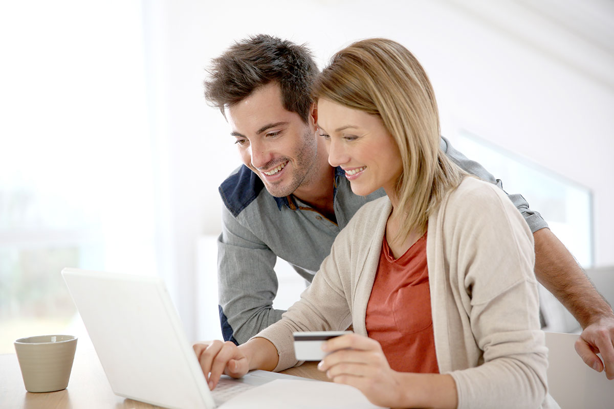 Man and Woman using Online payment processing on laptop
